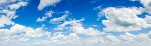 Beautiful blue sky with white wispy clouds.