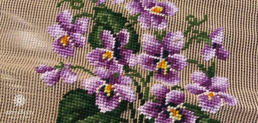 I learned to do needlepoint on a pre-worked needlepoint canvas like this one.